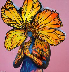 Flight of life: Butterflies or possibly sunflowers have inspired this artist to come up with this bright and colorful design