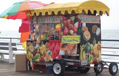 Fruit Stand Photograph - Fruit Stand On The Santa Monica Pier by Rauno Joks