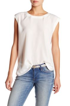 dd19165e9adf00 A simple white blouse is an essential wardrobe staple all year long. Work  Shirts