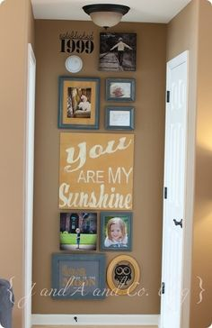 "@Kim Larson Fredericks  this is the pin I was thinking of. I m ow it isn't the wall format or the frame colors. Just the mixture of frames, signs, and canvas. It's eclectic but balanced. Plus I think the ""You're my sunshine"" would go great with the yellow. Just my thoughts :)"
