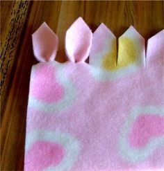 Cute way to finish a fleece blanket.  These are so quick and adorable for babies.  The love the edge!
