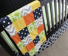 color scheme: Navy, Orange, Yellow, Lime Green and Grey Baby Bedding