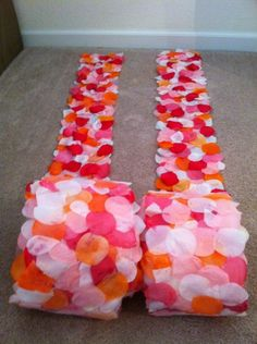 DIY Aisle Runners To Line The Sides Of The Aisle. No petals to clean up after the ceremony. This is very easy to do. Buy an inexpensive aisle runner, cut two strips of equal width and length, then glue on silk petals that match the colors of your wedding, Make sure to cover the runner so it looks like the petals are scattered along the aisle. You can find cheap silk petals at dollartree.com