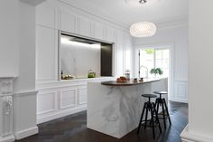 The Hidden Kitchen by Minosa Design was designed for this early Victorian terrace house in Sydney, Australia. A young professional couple wanted a simple yet elegant kitchen that blended in with the wall panellings. Parisian Kitchen, Kitchen Rustic, Kitchen White, Contemporary Kitchen Cabinets, Contemporary Kitchens, Hidden Kitchen, Long Kitchen, Kitchen Modern, Cuisines Design