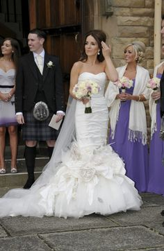 Ian Stuart dress...love the bride's simple hair and plain cathedral veil, all accented with the vintage-style drop earrings.