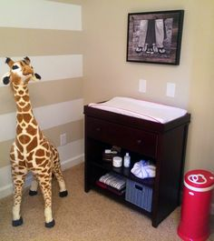 Fisher Price Changer, Large Stuffed Giraffe and Ubbi Diaper Pail in a Gender Neutral Nursery