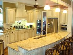 Open kitchen design that will be in new house. LOVE the cabinets at varying levels as well as the distressed look.