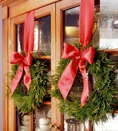 wreaths on cabinet doors of china cabinet or the pantry door