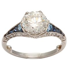 1stdibs - Art Deco Diamond,Sapphire and Platinum Engagement Ring   Not sure how I feel about introducing other colors, but this one's pretty