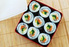 Kimbap... YUMMMMMMM.....  (tastes great vegetarian-style too, just leave out the beef... and maybe the fishcake...)