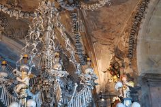 The Sedlec Ossuary is a small Roman Catholic chapel, located beneath the Cemetery Church of All Saints in Sedlec, a suburb of Kutná Hora in the Czech Republic. The ossuary is estimated to contain the skeletons of about 40,000 people, whose bones were artistically arranged from 1870 onwards by a Czech woodcarver by the name of Frantisek Rint.