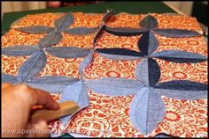 Here is a great tutorial of the circle jean quilt I'm making. I'm still only in the cutting stages and I plan to use different colored fabrics in each square.