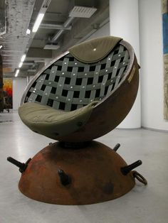 """chair made from mine shell...wouldn't have it in my house but I like """"trench art"""""""