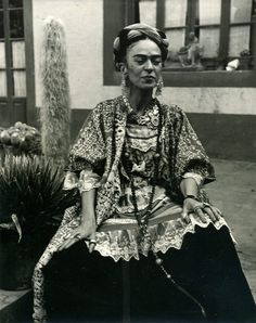 fyeahfridakahlo: aintgotnogrammar: sealmaiden: Frida Kahlo in her garden at Coyoacán, 1952 Photograph : Berenice Kolko via archivefrida