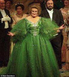 In a splendid green gown