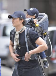 Miranda Kerr Goes Sheer While Her Boys Wear Matching Baseball Hats: Orlando Bloom carried his son, Flynn, on his back while out in NYC.