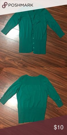 3/4 sleeve cardigan 3/4 sleeve button front cardigan. Button detail on sleeves. Teal green color. Used. Maurices Sweaters Cardigans
