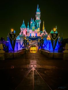 """Disneyland Sleeping Beauty's Castle decorated for the """"Diamond Celebration"""" lite up at night"""