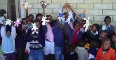 Children recieving Beanie Babies whilst waiting in line to see the Doctor.  Lesotho Africa.