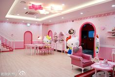 http://taizh.com/wp-content/uploads/2014/11/Stunning-room-interior-design-with-hello-kitty-theme-interior-with-red-white-star-lighting-ceiling-ideas-and-pink-wallpaper-as-well-wooden-furniture-set-on-wooden-laminate-floor.jpg