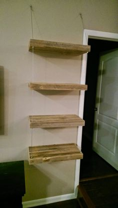 Made these floating shelves with steel cable supports.