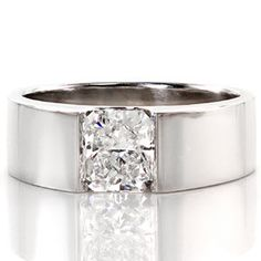 Simple, modern diamond solitaire engagement ring. A wide flat band holds a radiant cut center stone in a half bezel setting. Solstice from Knox Jewelers  #solitaire