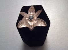 Sterling silver orchid ring with blue topaz center