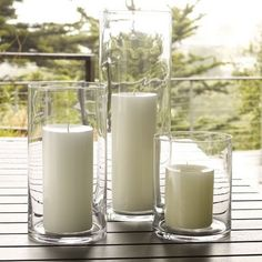 Simple Hurricane modern candles and candle holders to line the aisle