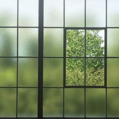this isn't exactly what a window set in polycarbonate would look like, but it gives you an idea.: