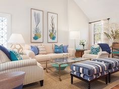 House of Turquoise: Sophie Metz Design.  Love the mix of pillows and the pretty blue colors chosen!