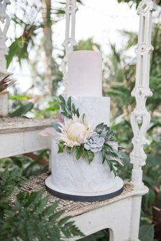 Boho Ibiza Wedding Cake, Peach wedding cake, textured wedding cake, colour washed wedding cake, sugar protea, sugar succulents, sugar greenery Image by Jenny Maden Photography