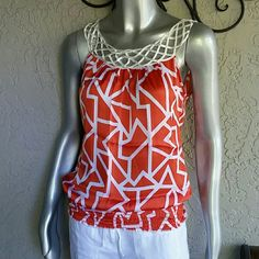 Silky Abstract Braided Neck Top by Charlotte Russe Brand Charlotte Russe  Size Small  100 % Polyester Silky Awesome like new condition  Sleeveless Orange & White Abstract print with Braided fabric neck line Stunning look, WIDE Elastic waistband Bundles available with discounts Charlotte Russe Tops Blouses