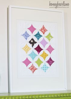Cathedral Window quilted wall art at Honeybear Lane ~link to a free CW tutorial