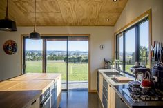 A simple functional design combining concrete, Oak and Lino. A contemporary take on a farmhouse style kitchen. Kitchen Island Nz, Kitchen Furniture, Cool Furniture, Furniture Dolly, Plywood Kitchen, Plywood Cabinets, Kitchen Wood, Kitchen Ideas, Galley Kitchen Design