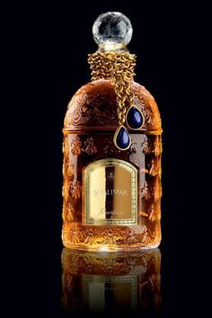 "Shalimar is my mother's favorite, and has been for many decades. ""Guerlain has given its classic scent Shalimar a Flacon Imperial Bijoux bottle featuring a gorgeous lapis lazuli necklace (only 20 copies produced, each ) Guerlain Perfume, Perfume And Cologne, Perfumes Vintage, Antique Perfume Bottles, Vintage Bottles, Glas Art, Beautiful Perfume, Perfume Collection, Bottle Design"