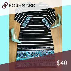 Blk/Wht Striped Dress Ronni Nicole dress. Black/white stripe with blue detail on the ends. Straight line dress, with 3/4 sleeves. Ronni Nicole Dresses