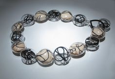 """Marianne Kohler - """"Necklace,"""" blown borosilicate glass, paper with drawings, rubber string"""