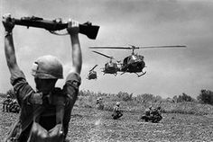 A US soldier guides helicopters into a swampy area on the northern edge of the Mekong Delta. Photograph: Henri Huet/AP