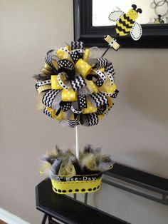 1st Bee-day party centerpiece. Birthday party for bumble bee theme done for Alexis's 1st bee-day :)