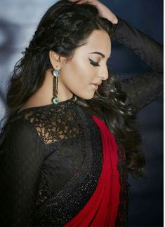 Actress Sonakshi Sinha in a lacy black long sleeved full front neck saree blouse...