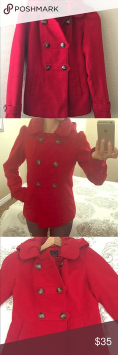 Material Girl Red Coat Cozy bright red double breasted coat by Material Girl. I love that this piece has a detachable hood, two front pockets to keep your hands warm, and more importantly is nicely lined. The coat is a bit more on the fitted side for someone who's Petite like me, this is sure to fit you beautifully. Material Girl Jackets & Coats Pea Coats