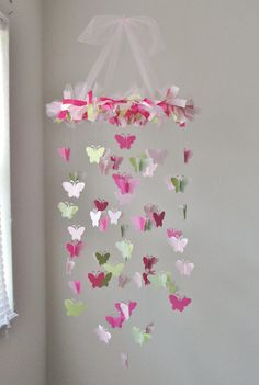 Butterfly Chandelier Mobile in Light pink, dark pink, and grassy green. $55.00, via Etsy.