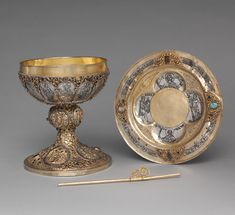 Chalice, Paten, and Straw, ca. 1230–1250. German. Silver, gilded silver, niello, and jewels. The Metropolitan Museum of Art, New York, The Cloisters Collection, 1947     (47.101.26–.28)  The straw in this set is a very rare survivor