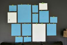 A Beautiful Mess: Plan out the frame arrangement for your gallery wall by using paper cut to the size of your frames and experiment with placement with painter's tape or sticky-tack
