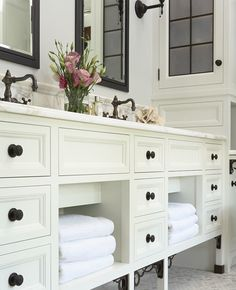 Suzie: Susan Gilmore Photography! creamy ivory bathroom cabinets, black mirrors, calcutta gold ...