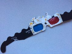 3D glasses made from popcorn carton and colored candy paper from Quality Street.