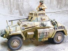 World War II German Winter CS00574 SD.KFZ. 222 Armored Car set - Made by The Collectors Showcase Military Miniatures and Models. Factory made, hand assembled, painted and boxed in a padded decorative box. Excellent gift for the enthusiast.