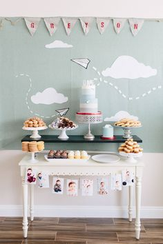 Greyson's first birthday paper plane themed cake table