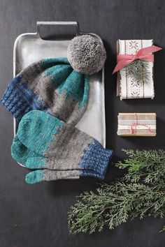 Could this set be any more lovely?! 😍😍 The Shaded Hat & Mittens are made from a decadent Merino-and-yak blend yarn in three colors. Worked in the round from the bottom up, each piece starts with mock-cable ribbing, and the hat is topped with a pom-pom. Designed by Antonia Cavaliere. Find the pattern: Crochet Mittens Pattern, Knit Mittens, Knitting Patterns, Crochet Gloves, Knitted Hats, Intarsia Knitting, Knitting Socks, Hand Knitting, Knit Socks