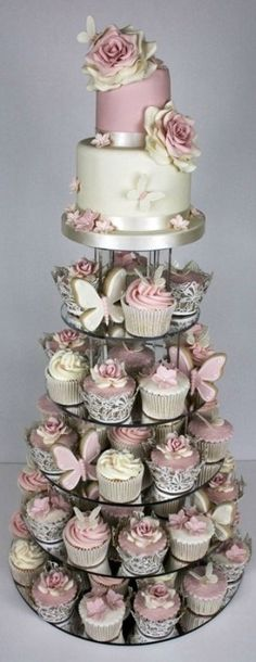 Are big, several tiered wedding cakes overrated? Perhaps you are not one for some wedding cake? Then go for this creative idea. Keeping the traditional cake but having some small wedding inspired cupcakes for your guests to take their pick of. Wedding Cake Designs, Wedding Cupcakes, Party Cupcakes, Pink Wedding Cakes, Butterfly Wedding Cake, Small Wedding Cakes, Luxury Wedding Cake, Wedding Sweets, Butterfly Baby